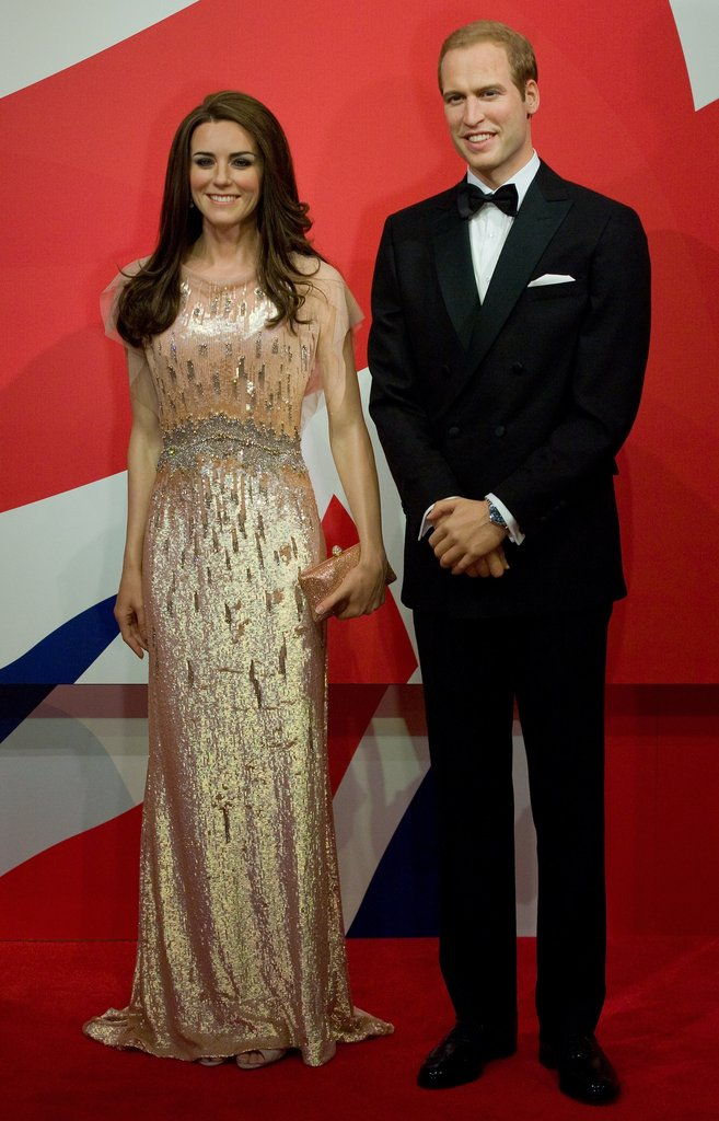 Wearing their outfits from the Ark dinner in 2011, wax Will and Kate looked pretty sharp!