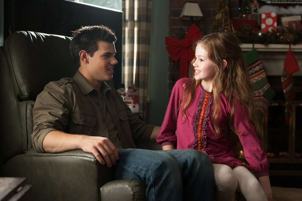 Taylor Lautner as Jacob and Mackenzie Foy as Renesmee in Breaking Dawn Part 2.
