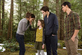 Kristen Stewart as Bella, Mackenzie Foy as Renesmee, Taylor Lautner as Jacob, and Robert Pattinson as Edward in Breaking Dawn Part 2.