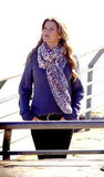 Gisele Bundchen wore a scarf and blue sweater in Brazil.