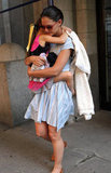 Suri Cruise wrapped herself around mom Katie Holmes in NYC.