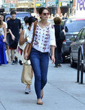 Katie Holmes gave her dressed-down denim a boho twist with a printed peasant top.