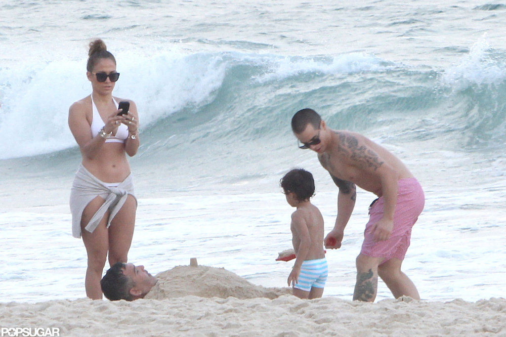 Jennifer Lopez played on the beach in Rio de Janeiro with Casper Smart, Max, and Emme in June 2012.