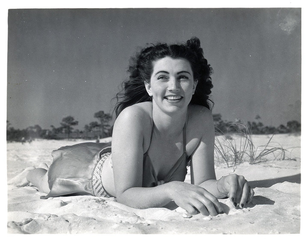 1940s A beach bunny enjoyed a sunny day in the sand. Source: Flickr User rich701