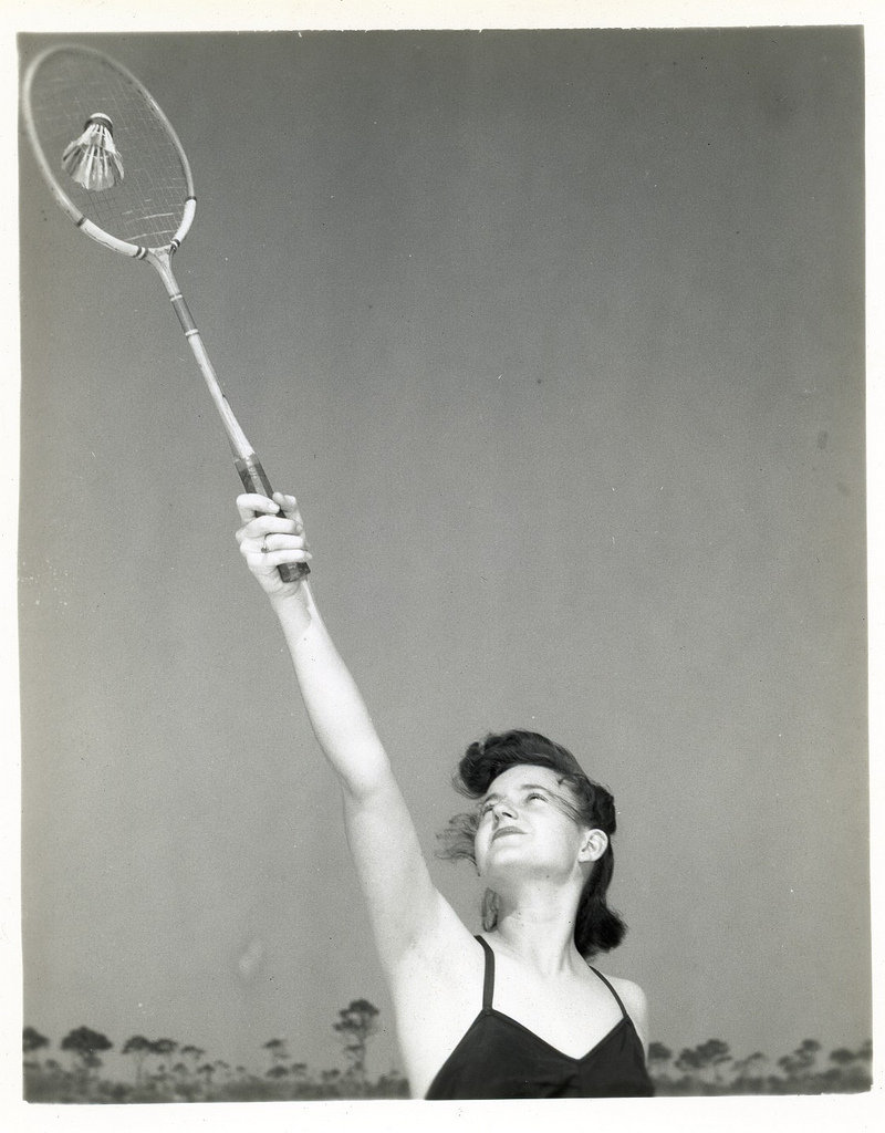 1940s A woman played badminton on a beach.  Source: Flickr User rich701