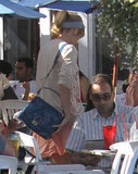 Taylor Swift carried a blue handbag.