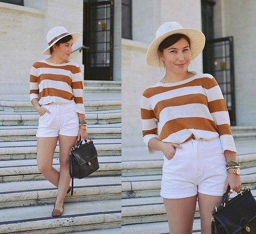 We love this less-is-more look: a lightweight sweater tucked into high-waisted shorts gives off a cool, boyish daytime vibe. Photo courtesy of Lookbook.nu