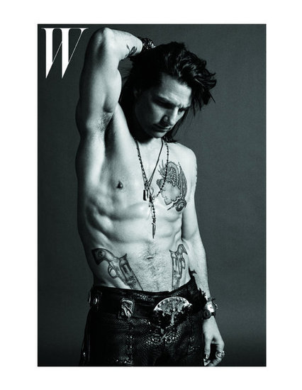 Tom Cruise posed shirtless on the cover of W magazine, showing off his spread of tattoos for Rock of Ages in June 2012.