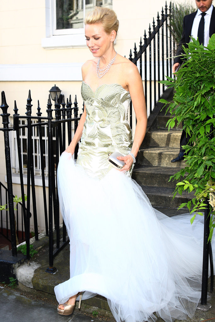 Naomi Watts headed to Elton John's White Tie & Tiara party in London.