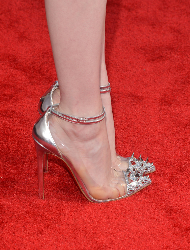 The metallic sheen and spiked cap-toes on Emma's Louboutin pumps packed a serious punch.