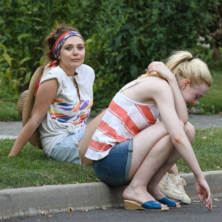 Dakota Fanning and Elizabeth Olsen Ride Bikes on the Set of Their New Film: Very Good Girls