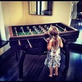 Busy Philipps shared this cute photo of her daughter, Birdie Silverstein, playing foosball. Source: Instagram User busyphilipps