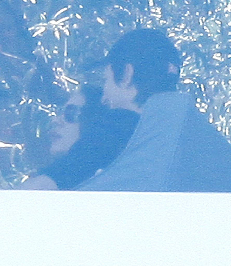 Ashton Kutcher cuddled with Mila Kunis at Soho House.