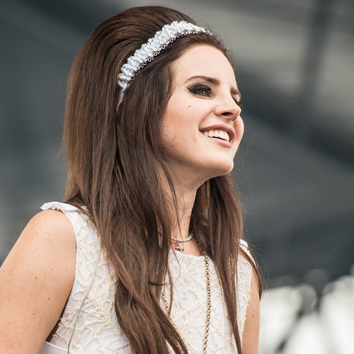 Lana Del Rey Wears a White Mini Dress on Stage: Video