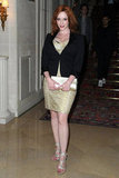 Christina Hendricks showed off her curves and played with metallics in a gold, fitted mini and strappy, silvery heels.