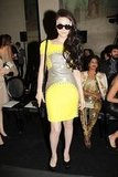 Fan Bingbing demonstrated ample fashion flair in a fitted, vibrant yellow Versace dress and cat-eye sunglasses.