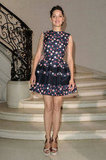 Marion Cotillard was sweet, girlish perfection in a floral-print fit-and-flare dress and satin wedges for Christian Dior's show.
