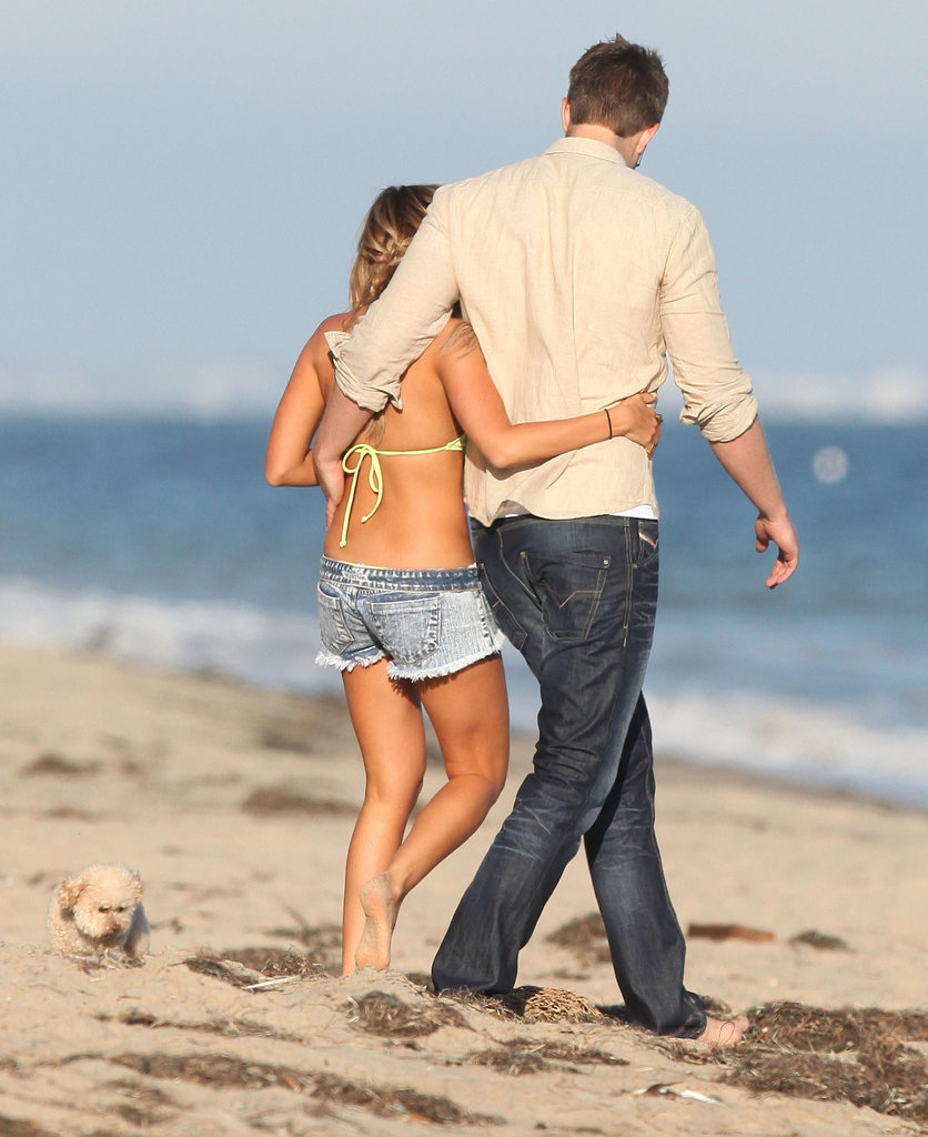 Ashley Tisdale and boyfriend Scott Speer were arm in arm for her birthday celebration on the beach.