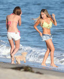 Ashley Tisdale spent her birthday on the beach in a green bikini.