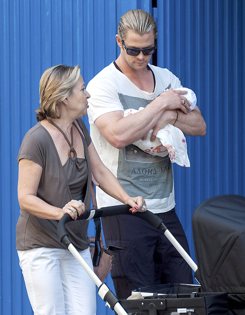 Chris Hemsworth held India tight while walking around Madrid.