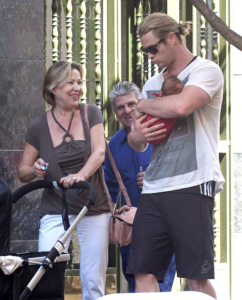 Chris Hemsworth held baby India in Madrid.
