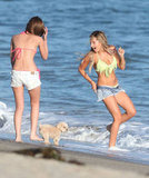 Ashley Tisdale ran into the water in a green bikini on the beach in Malibu.