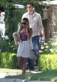 Ashley Tisdale carried her dog while boyfriend Scott Speer followed in LA.