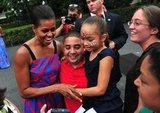 Firs Lady Michelle Obama hugged it out at a BBQ for White House staff and armed servicemen and women in 2011.