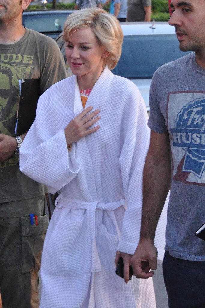 Naomi Watts covered up in a robe.