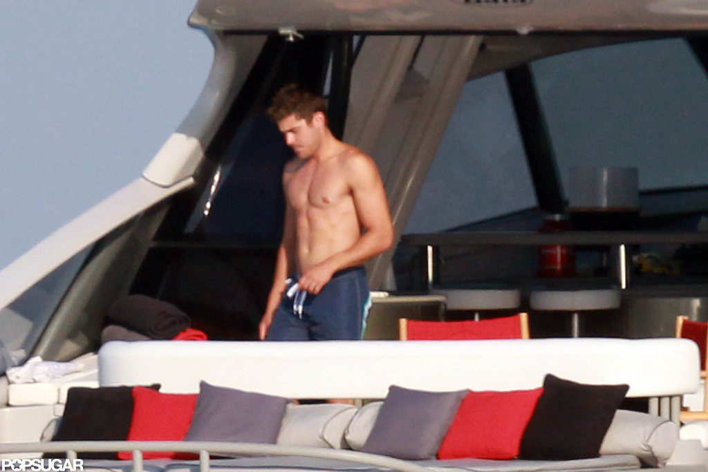 Zac Efron took off his shirt and soaked in the rays.