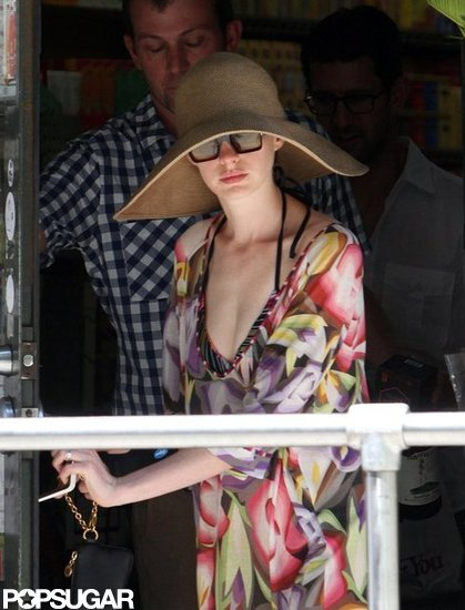 Anne Hathaway was ready for Summer in a floral cover-up and floppy hat.