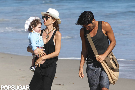Rachel Zoe held Skyler on the beach with a friend.