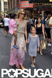 Heidi Klum held tight to her little ones in NYC's Times Square.