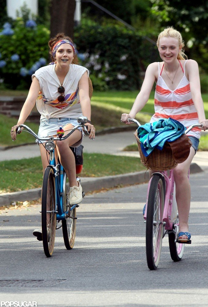 Elizabeth Olsen and Dakota Fanning rode bikes through the streets of NYC.