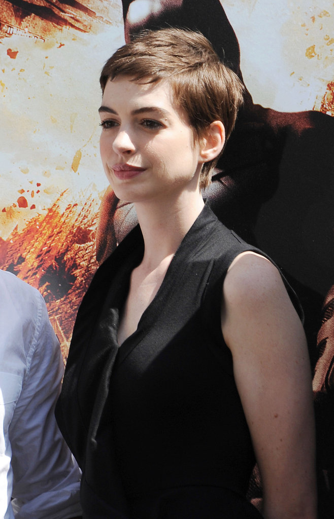 Anne Hathaway posed at Christopher Nolan's hand and footprint ceremony in LA.