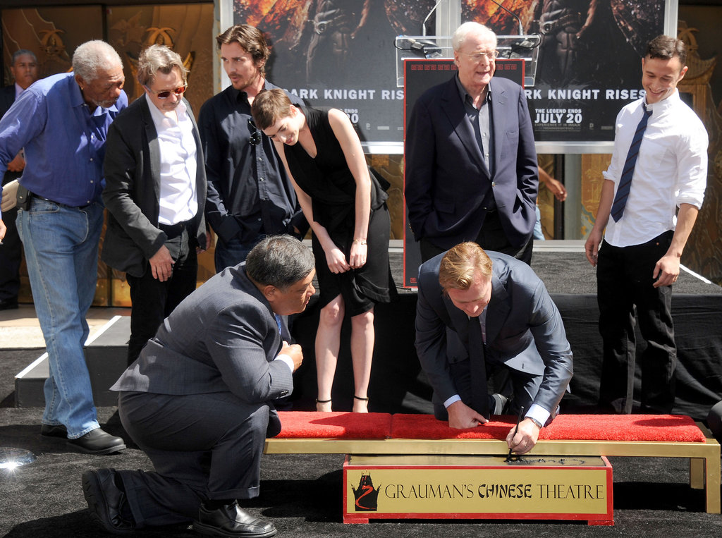 Christopher Nolan was supported by Anne Hathaway, Christian Bale, Gary Oldman, Joseph Gordon-Levitt, Morgan Freeman, and Michael Caine for his hand and footprint ceremony in LA