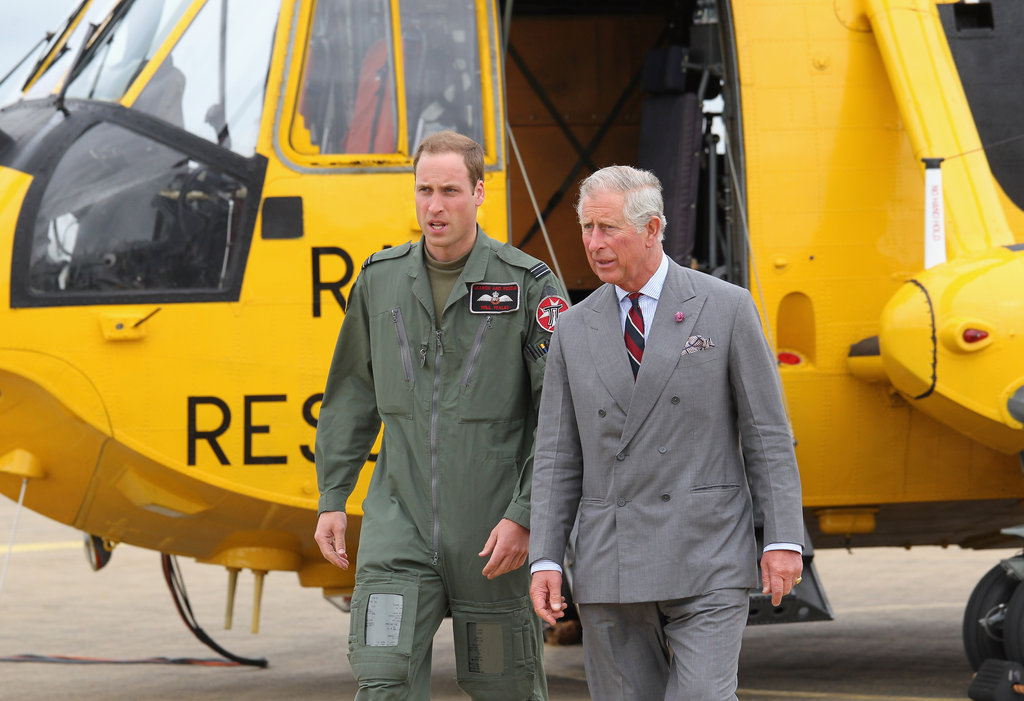 Prince William looked handsome in his uniform while Prince Charles was in a suit.