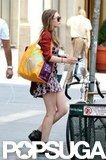 Elizabeth Olsen carried a loaf of bread.