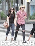 Jamie Campbell Bower and Lily Collins held hands in Toronto.