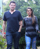 Cory Monteith and Lea Michele linked arms.
