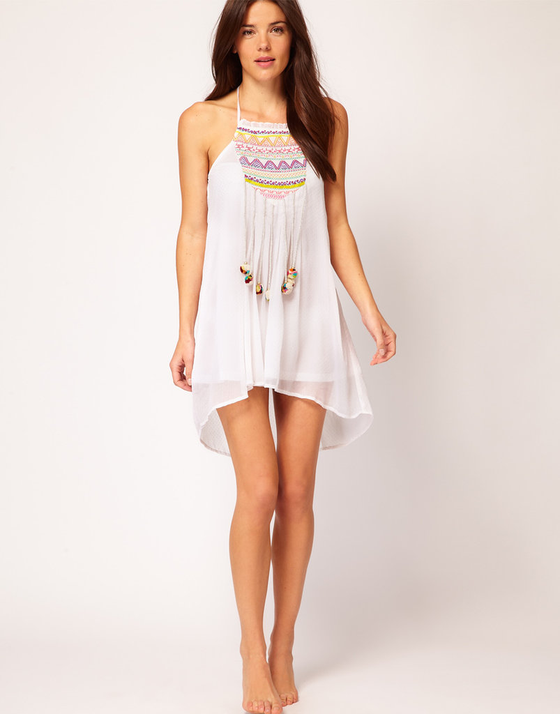 Embrace a little boho-chic with this breezy pom-pom mini. River Island Embroidered Pom Pom Dress ($46)