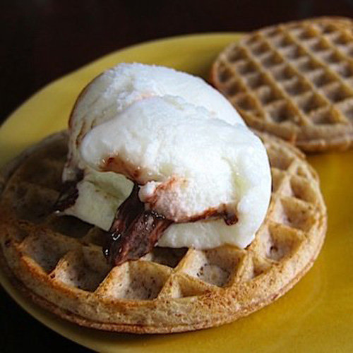 This Summer has been a scorcher, so why not cool off with this recipe for whole grain waffles topped with frozen yogurt? This icy topping is the perfect alternative to sugar-laden syrup. Who says a diet can't be delicious?