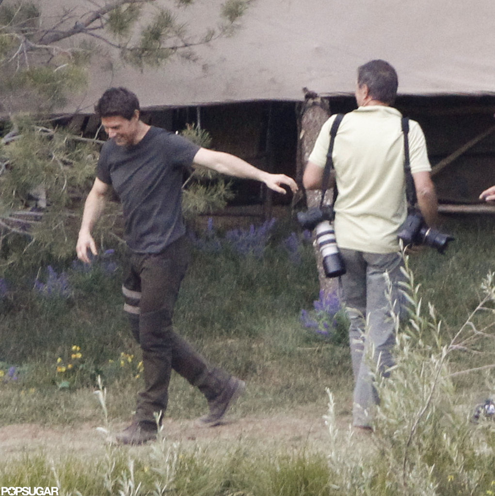 Tom Cruise left a conversation laughing on the set of Oblivion in June Lake, CA.