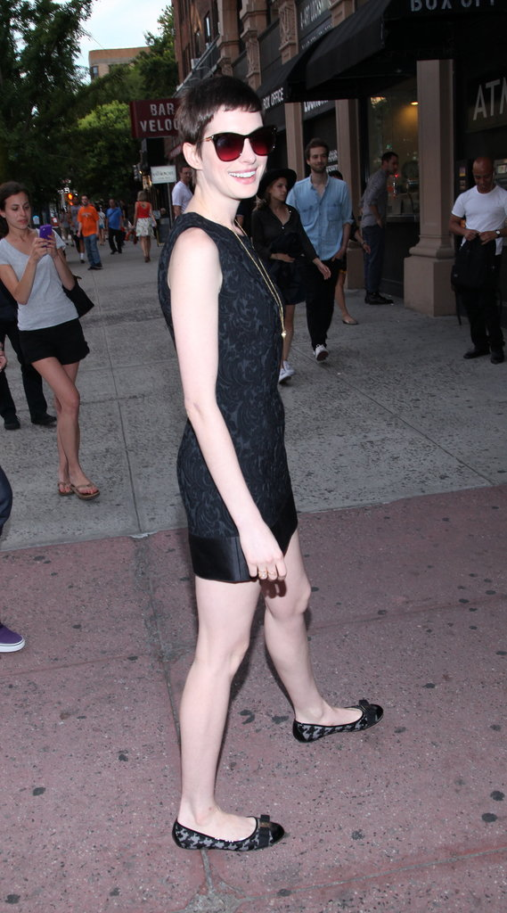 Anne Hathaway posed in a Dolce & Gabbana number for the Shut Up & Play the Hits screening in NYC.