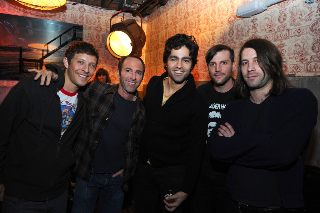 Adrian Grenier posed with friends at the Shut Up & Play the Hits party in NYC.