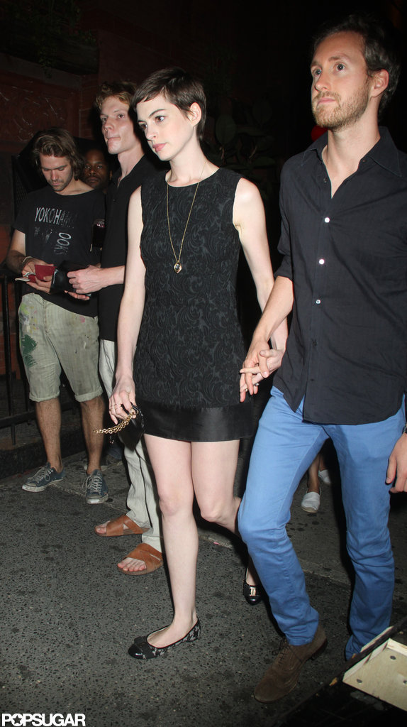 Anne Hathaway and Adam Schulman held hands at the Shut Up & Play the Hits screening in NYC.