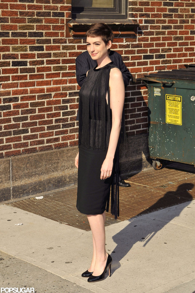 Anne Hathaway sported a black dress.