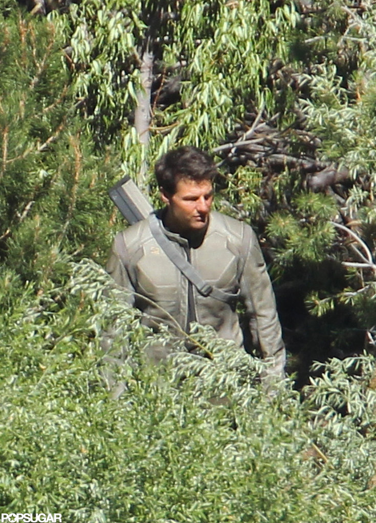 Tom Cruise made his way through thick brush on the Oblivion set in CA.