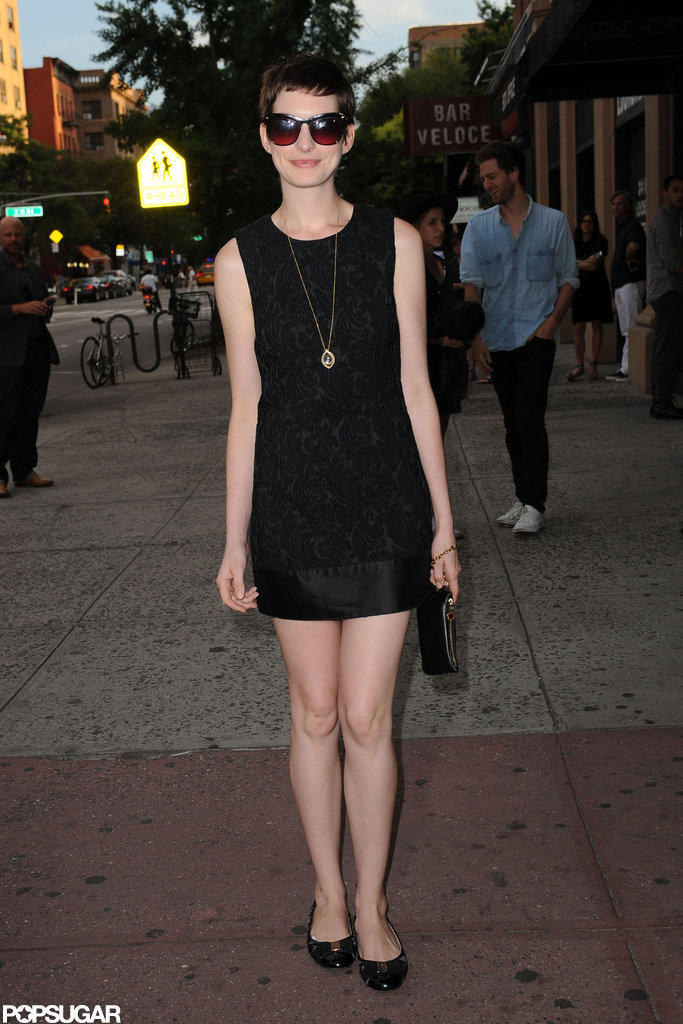 Anne Hathaway posed at the Shut Up & Play the Hits screening in NYC.