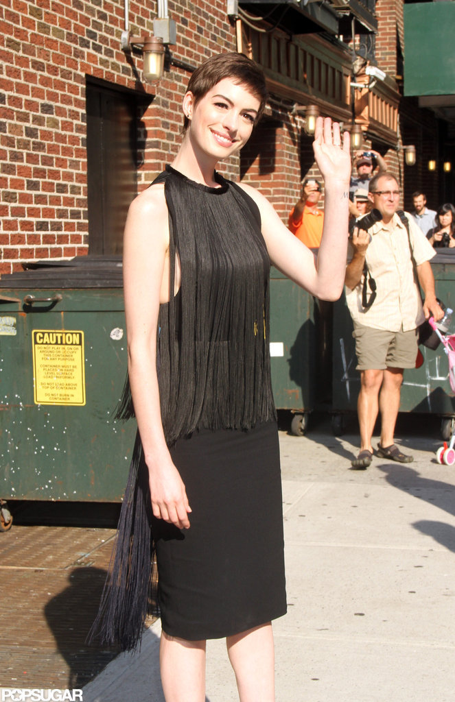 Anne Hathaway smiled at onlookers.